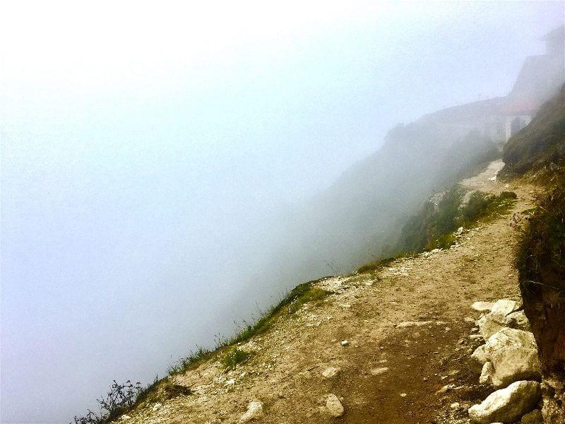 Vertigo inducing views on a foggy hike from Namche Bazaar to the Everest View Hotel