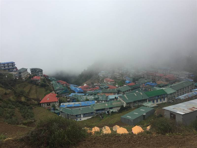 Namche Bazaar is a U-shaped town on a Himalayan mountainside, once Sherpa trading post and now respite for weary trekkers