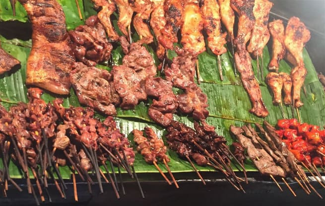 """The street meat in Chiang Mai, Thailand includes some delicious things...but their are some oddities hidden among them...like pig intestines and """"mud cutters"""". Can you spot them?"""