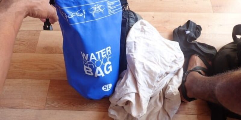 How to Wash Clothes Without a Washer While Traveling Using a Dry Bag and Dish Detergent