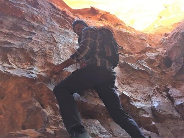 Climbing through Wadi Rum Jordan in the Outlier Slim Dungarees