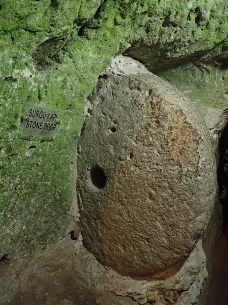 A large boulder designed to block entry to the cave's tunnels if attacked | The Cappadocia Green Tour